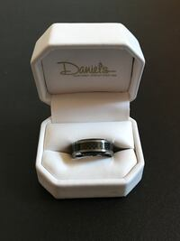 silver-colored Daniel's ring with box