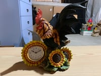 Rooster statue with clock