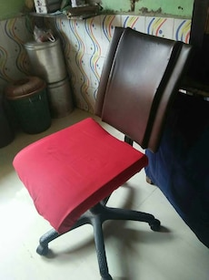 red and brown rolling chair