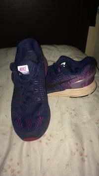 Pair of purple nike running shoes Abbotsford, V2T 3L3