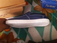 unpaired blue and white Nike low-top sneaker Delhi, 110053