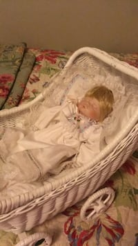 porcelain baby doll and woven  pram 2387 mi