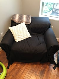 black fabric sofa chair with throw pillow null