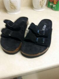 pair of black leather sandals Quinte West, K8V 6A8