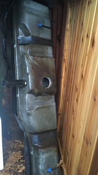 Gray steel gas tank for a Chevy express