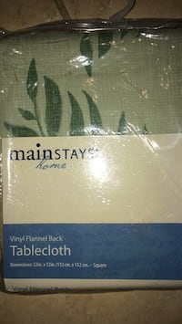 52 x 52 table cloth $5.00. New in package