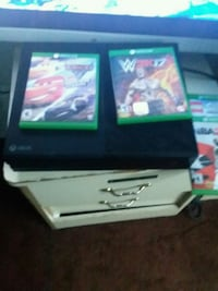 black Xbox One console with game cases San Francisco, 94110