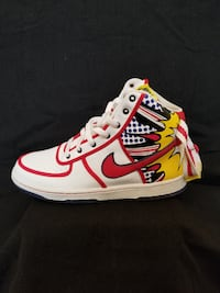 unpaired red and white Vans high-top sneaker PLANO