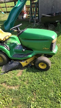 Green and yellow john deere ride on lawnmower 62 km