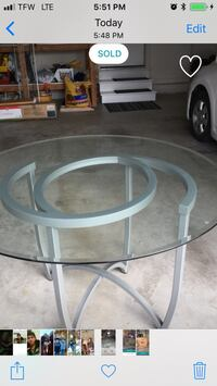 round glass top table with gray metal base Des Moines, 50315