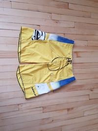 yellow, black and white Quiksilver board shorts