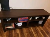 brown wooden TV stand with flat screen television Pharr, 78577