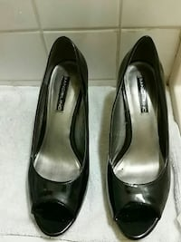 pair of black Badolino patent leather open-toe heel shoes