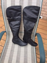 pair of black leather knee-high boots St Catharines