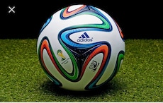 white, red, and green Adidas soccer ball