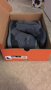 pair of black leather boots with box