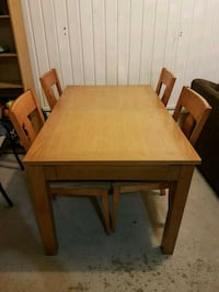 rectangular brown wooden table with four chairs di Candiac, J5R