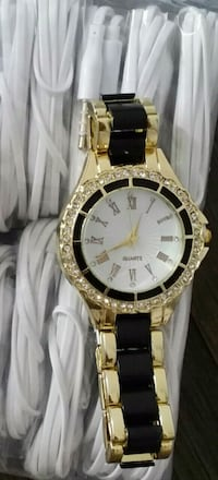 round gold-colored analog watch with black leather strap Montréal, H1Z 3G4