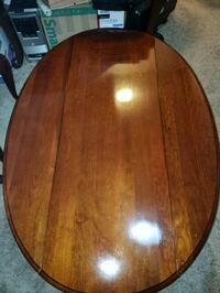 oval brown wooden coffee table and 2 end tables Charles Town, 25414