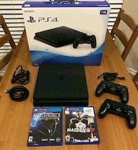 black Sony PS4 console with controller and game cases Baltimore, 21217