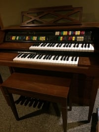 Brown electronic organ with brown wooden bench lowery genie 88