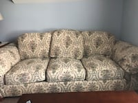 gray and white floral 3-seat sofa