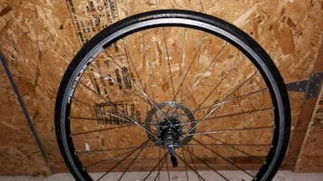 700 cc black bicycle wheel with tire