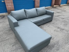 FREE DELIVERY - GREYISH SECTIONAL COUCH W/ PULLOUT BED- GREAT COND