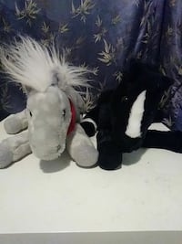 two gray and black horse plush toys