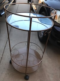 Vintage gold bar cart with mirror shelf and wine rack Tempe