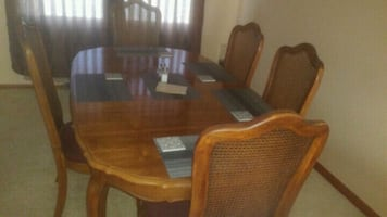 Dining room table and 5 chairs and 3 leaves