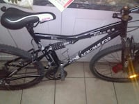 black and white Mongoose full-suspension mountain bike Calgary, T3B 1L3