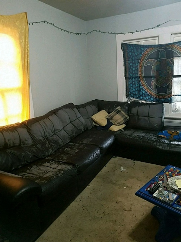 Used Black Leather Sectional Sofa With Throw Pillows For Sale In