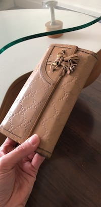 Authentic Gucci nude wallet sold AS IS  Vancouver, V5R