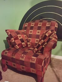 Red and brown square patterned sofa couch. Comes with 2 pillows. Fair condition.