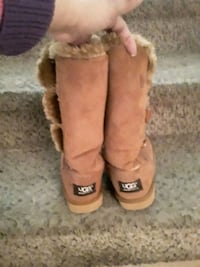 pair of chestnut UGG Bailey Button boots
