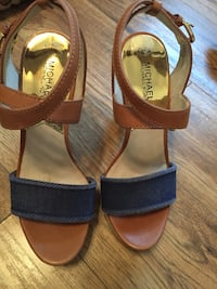 Pair of brown-and-black leather sandals London, N6E 2W8