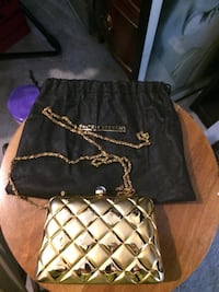 quilted gold-colored crossbody purse with drawstring bag