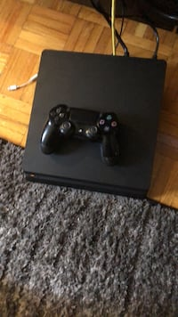 black Sony PS4 console with controller 552 km
