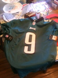 blue and white NFL jersey shirt 51 mi