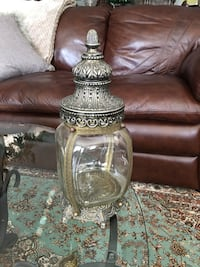 Glass jar with metal cover and stand
