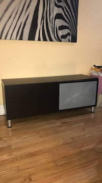 "Besta Tv console for tvs up to 42-50"" its in very good condition dark brown color.  West New York, 07093"