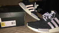 pair of black-and-white Adidas NMD_R1 with box
