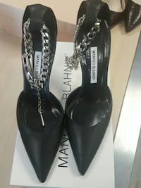 pair of black Manlolo Blahnk pointed heels