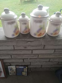 four white and pink ceramic jars