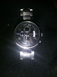 round silver-colored chronograph watch with link b San Antonio, 78223