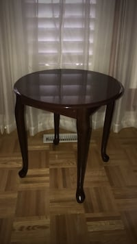 Round brown wooden end table.. italian made solid wood
