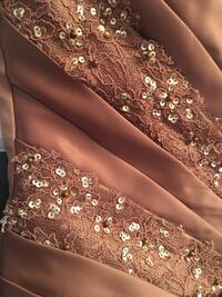 brown and white floral textile Carignan, J3L 6W8