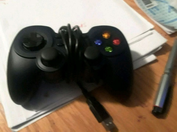 black and gray corded game controller