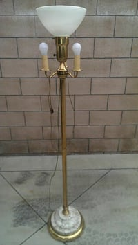 gold and white torchiere floor lamp